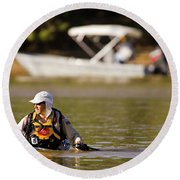 Racer Wading Across A River In An Round Beach Towel