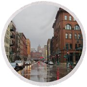 Rain On Water Street 1 Round Beach Towel