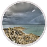 Rainbow In Storm Clouds Pointe De Saint Cast  Round Beach Towel