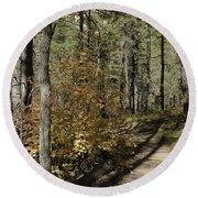 Red Among The Pines Round Beach Towel