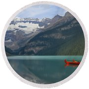 Red Canoes On Lake Louise Round Beach Towel