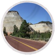 Red Road At Checkerboard Mesa Round Beach Towel
