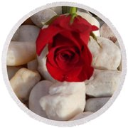 Red Rose On River Rocks Round Beach Towel