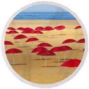 Red Umbrellas Round Beach Towel by Carlos Caetano
