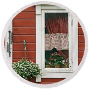 Red Wooden House With Plants In And By Round Beach Towel