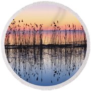 Reeds Reflected In Water At Dusk Ile Round Beach Towel