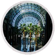 Reflecting On Palm Trees And Arches Round Beach Towel by Georgia Mizuleva