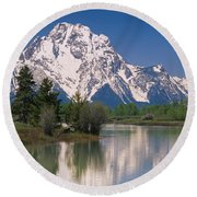 Reflection Of A Mountain Range Round Beach Towel