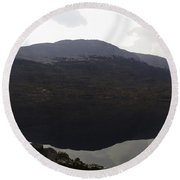 Reflection Of Hills In A Loch In The Scottish Highlands Round Beach Towel