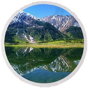 Reflection Of Mountains In Tern Lake Round Beach Towel