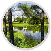 Reflections In A Tranquil Pond Round Beach Towel