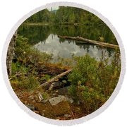 Reflections In Starvation Lake Round Beach Towel