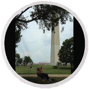 Relaxing By The Washington Monument Round Beach Towel