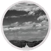 Remote Desert Road To Mountains Round Beach Towel