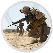 Rifleman Kneels To The Ground While Round Beach Towel