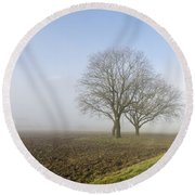Road In The Fog Round Beach Towel