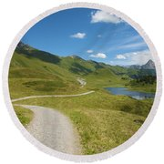 Road In The Mountains Round Beach Towel