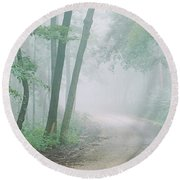 Road Passing Through A Forest, Skyline Round Beach Towel