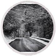 Road Through Dark Snowy Forest E93 Round Beach Towel