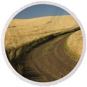 Road Through Wheat Field Round Beach Towel