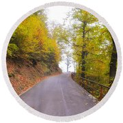 Road With Autumn Trees Round Beach Towel