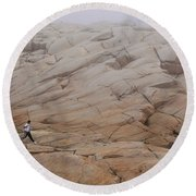 Rock Jogger At Peggy's Cove Round Beach Towel
