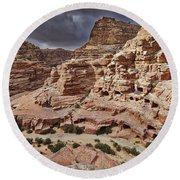 rock landscape with simple tombs in Petra Round Beach Towel