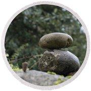 Rocks In The Garden Round Beach Towel