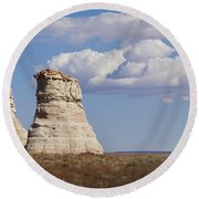Rocky Buttes Protrude From The Middle Of Arizona Landscape Round Beach Towel