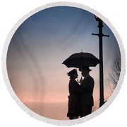 Romantic Couple Under A Street Lamp At Sunset Round Beach Towel