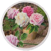 Roses In An Earthenware Vase By A Mossy Round Beach Towel