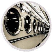 Row Of Washing Machines In Laundromat Round Beach Towel