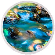Rushing Water Over Fall Leaves Round Beach Towel