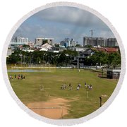 Schoolchildren Practicing On Playing Field With Singapore Skyline In Background Round Beach Towel