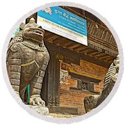 Sculptures Of Protector Figures In Front Of Sufata Buddhist College In Patan Durbar Square Round Beach Towel