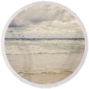 Seagulls Take Flight Over The Sea Round Beach Towel