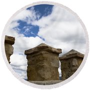 Segovia Wall Against Blue Sky Round Beach Towel