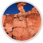 Serpent On The Cliff Round Beach Towel