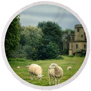 Sheep Grazing By Castle Round Beach Towel