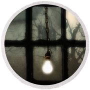 Lit Light Bulb Shines In Old Window Round Beach Towel