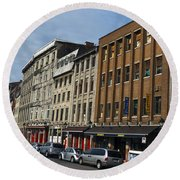 Shops And Buildings Along Rue Saint-paul Old Montreal Round Beach Towel