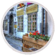 Shops And Flower Boxes Round Beach Towel