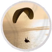 Silhouette Of A Paraglider Flying Round Beach Towel