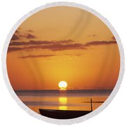 Silhouetted Boat Round Beach Towel