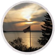Silhouetted Flag At Sunset Round Beach Towel