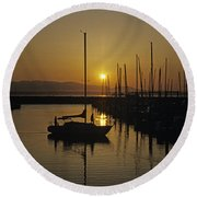 Silhouetted Man On Sailboat Round Beach Towel