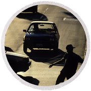 Silhouetted Skateboarder Round Beach Towel