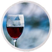 Single Glass Of Red Wine On Blue And White Background Round Beach Towel