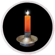 Single Orange Candle On Black Round Beach Towel
