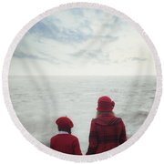 Sitting At The Sea Round Beach Towel